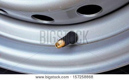 Air into a car tire new car.