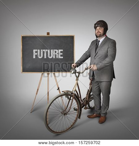 Future text on blackboard with businessman and vintage bike