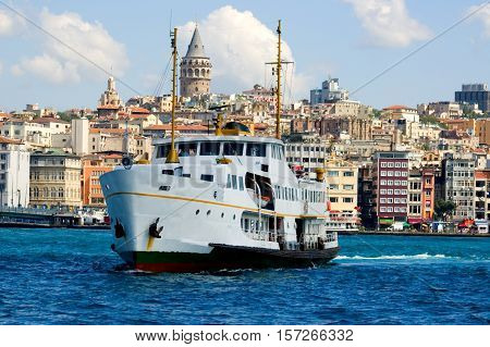 White ship in Bosporus with Galata Tower background