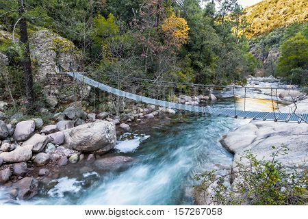 Steel Rope Bridge Across La Figarella At Bonifatu In Corsica