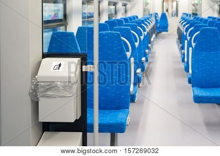Garbage container in the electric train in Moscow, Russia