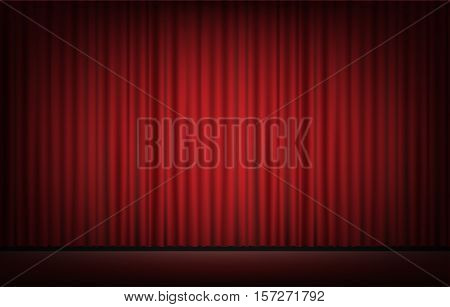 a real stage with red curtain background
