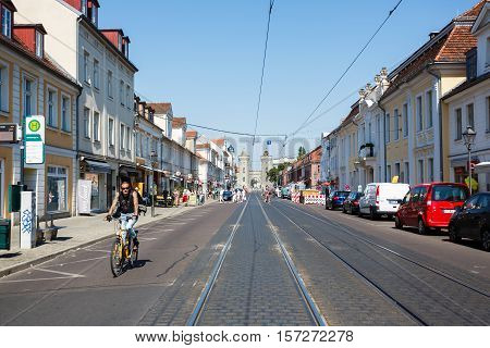 Potsdam Germany August 27 2016: Biker on a street of Potsdam in summer