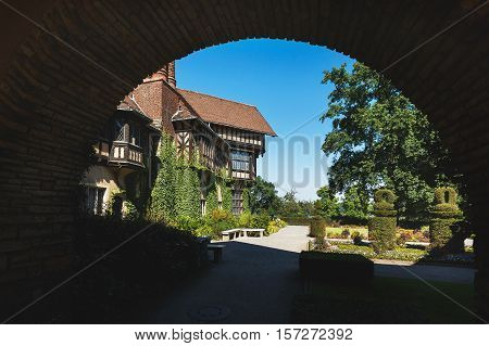 Potsdam Germany August 27 2016: View through the arch of the Cecilienhof Palace in Potsdam in summer