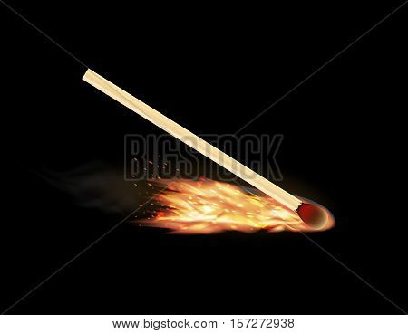a real burning matchstick on a black background