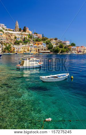 Scenic waterfront on the Greek island of Symi, Dodecanese, Greece. poster