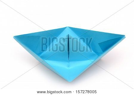 Blue paper boat. Origami boat isolated on white