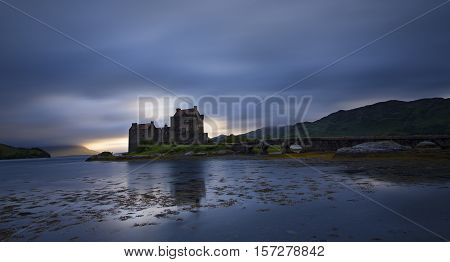 Eilean Donan Castle at Dornie on Kyle of Lochalsh in Scotland with a reflection