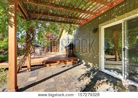 Back Yard With Pergola , Tile Floor And Wooden Walkout Deck