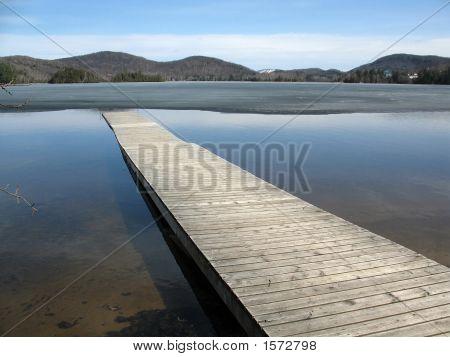 Dock Juts Into Half-Frozen Lake