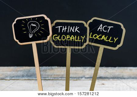 Concept Message Think Globally Act Locally And Light Bulb As Symbol For Idea