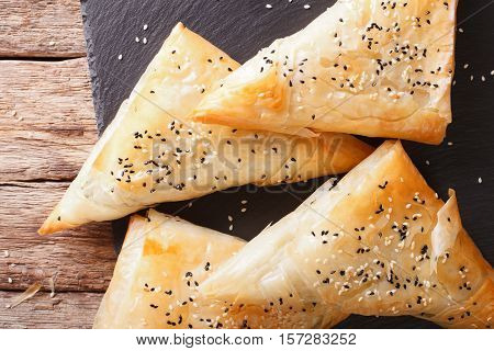 Triangles Of Phyllo Pastry Stuffed With Chicken, Spinach And Cheese Closeup. Horizontal Top View