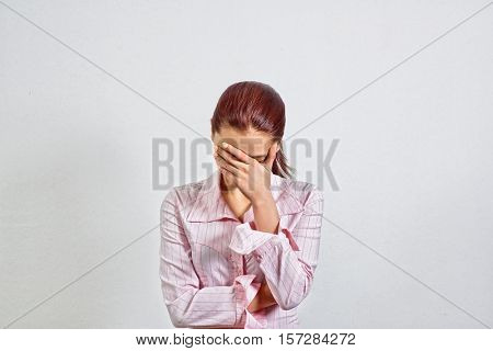 Unhappy Young Adult Female Wearing Blouse Covers Her Face by Hand, Gesturing She Has Made a Big Mistake, Shows Sings of Stress, Fear, Panic, Tiredness, Hopelessness