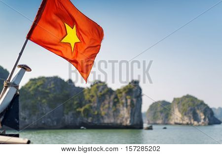 The Flag Of Vietnam On Blue Sky Background In The Ha Long Bay