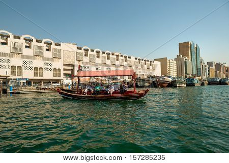 DUBAI UAE - NOVEMBER 10 2016: Close up of traditional wooden boat docked on Bay Creek. The creek is divides the city into two main sections Deira and Bur Dubai old downtown of Dubai.