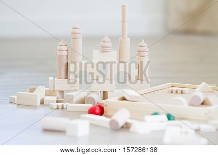 noname wooden bulding blocks, building castles and houses from wooden blocks at home