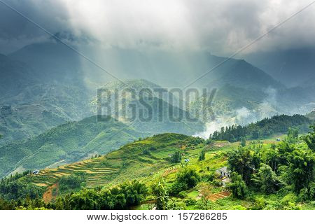 Rays Of Sunlight Through Storm Clouds In Mountains Of Vietnam