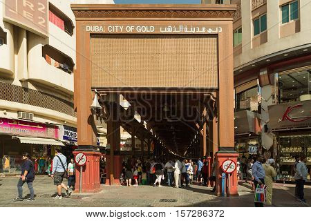DUBAI UAE - NOVEMBER 10 2016: Gold Souq Entrance. Shop and sellers with gold. Dubai