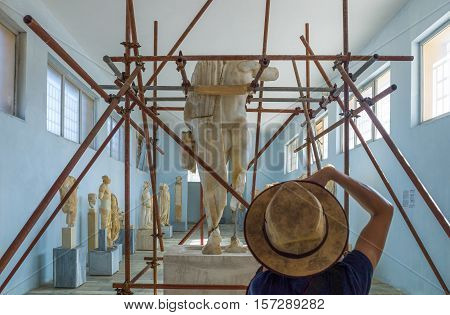 Delos Greece - October 17 2012: Archaeological site a tourist taking pictures in the Museum