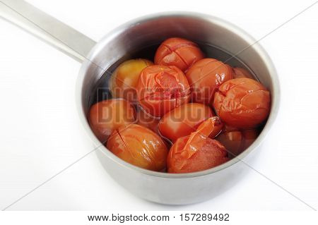 boiled tomato in pot for cooking food