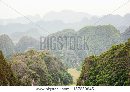 Scenic view of myriad karst mountains at the Tam Coc portion Ninh Binh Province Vietnam. Ninh Binh Province is a popular tourist destination of Asia.
