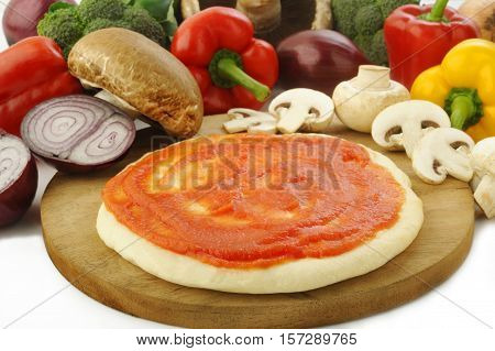 raw pizza dough and ingredient for baking