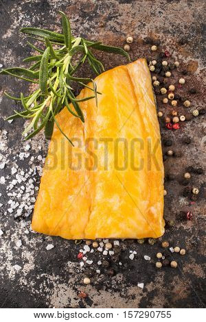 smoked coley with rosemary peppercorn and coarse salt on metal