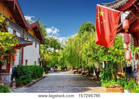 The Flag Of China (red Flag With Five Golden Stars) In Lijiang