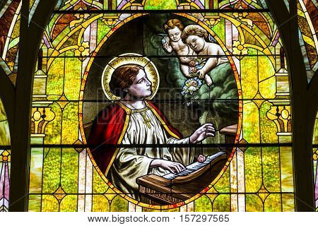Kokomo - Circa November 2016: Church Stained Glass Portraying Cherubs and Saint Cecilia the Patron Saint or Patroness of Musicians I
