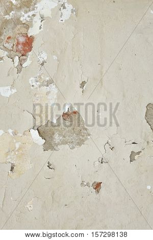 Dark Plaster Wall With Dirty White Black Scratched Vertical Texture. Old Brickwall With Peel Off Grey Stucco Background. Vintage Retro Worn Urban Wall. Abstract Decayed Cracked Rough Surface.