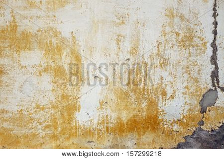 Old Limewash  Yellow Plaster Wall With Cracked Surface Background Texture