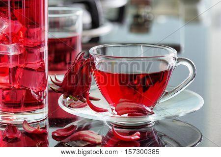 Cup Of Hibiscus Tea (rosella, Karkade) On Kitchen Table