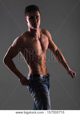 Portrait Of Naked Handsome Young Man With Languishing Look Wearing Only Jeans