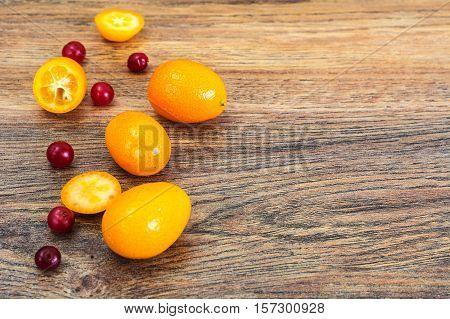 Fresh Orange Kumquats on Wood. Studio Photo