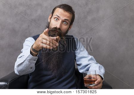 Businessman with a glass of whiskey is argueing with you trying to prove his point