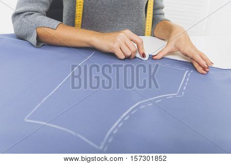 Woman With Measuring Tape Is Drawing A Pattern