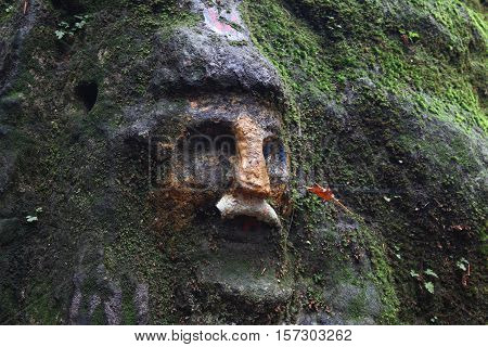 Dwarf face carved in the rock - rock relief from 1833