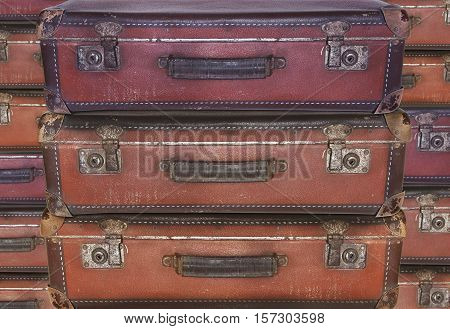Old worn warped travel suitcases - evacuation - migration