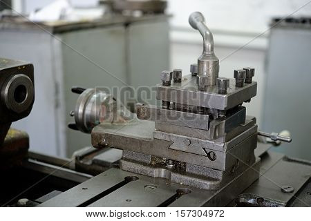 Part of lathe in workroom close up