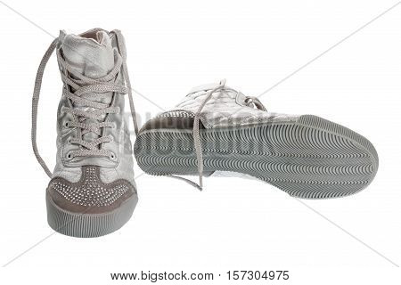 Silver sports gym shoes in rhinestones isolated on a white background