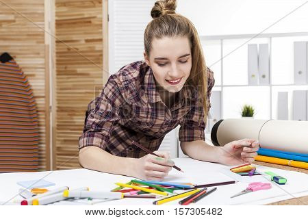 Close Up Of Woman Painter In Brown Shirt Sketching