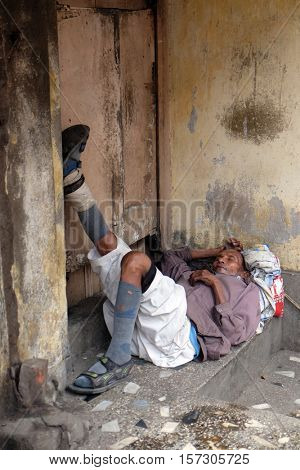 KOLKATA, INDIA - FEBRUARY 11: Homeless person sleeping on the footpath of Kolkata, India on February 11, 2016.