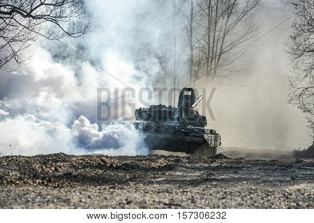 Russian tank t-72 shot on a forest road smokescreen