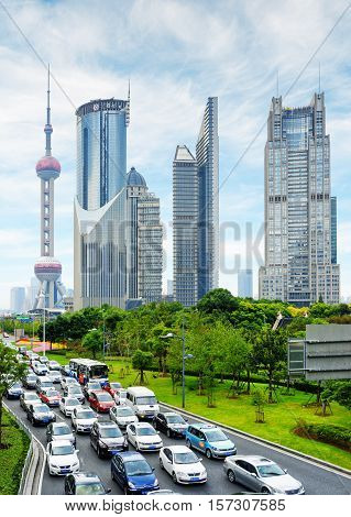 Modern City Traffic On Century Avenue In Downtown Of Shanghai