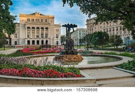 Latvian National Academic Opera and Ballet Theatre house in Riga while beautiful summer sunset light