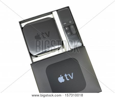 PARIS FRANCE - NOV 10 2015: New Apple TV media streaming player microconsole by Apple Computers futuristic touch remote swipe-to-select with integrated Siri and motion sensor - front view isolated on white