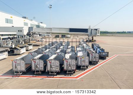 BRUSSELS, BELGIUM - MAY 13, 2016: Empty freight trolleys on the runway tarmac