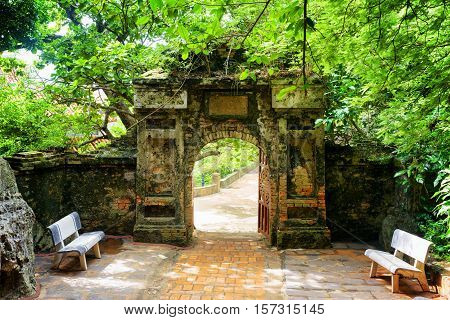 Old Stone Gate Leading Into Enigmatic Tropical Garden