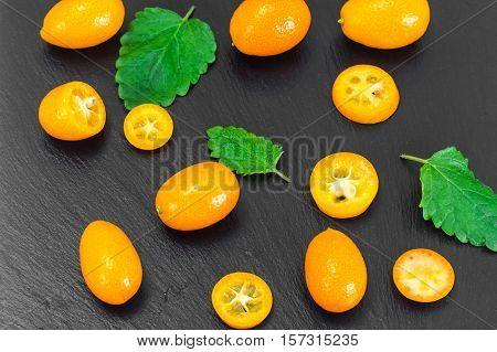 Fresh Orange Kumquats on White. Studio Photo