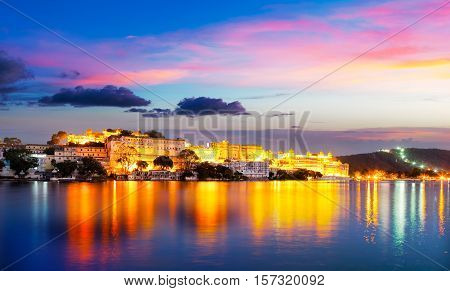 City Palace and Pichola lake in the evening light Udaipur Rajasthan India Asia